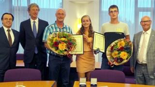Helen van Dijk met redders Albert en Kevin ten Kleij