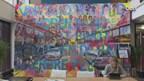 Honderd bewoners van de De Genestetstraat in Zwolle op groot schilderij
