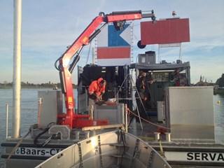 De onderwaterarcheologen aan het werk